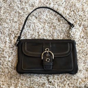 Brown leather authentic Coach wristlet